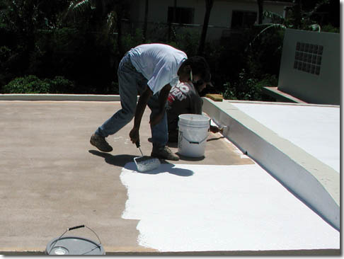 Roofer applying roof coating in Cedar Park TX